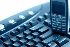Communication - PC keyboard and mobile phone Royalty Free Stock Photo