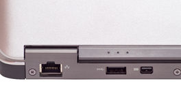 Communication ports. On the rear of an ultrabook showing the network port, a USB port and a display port Stock Photos