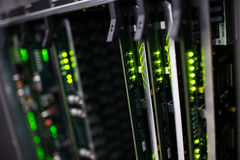 Communication racks. In a datacenter filled with switches and routers that keep all the servers connected Royalty Free Stock Image