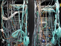 Communication racks. With messy cabling at rear Stock Image