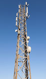 Communication radio tower with devices Royalty Free Stock Images