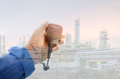 Communication. With Radio for work concept, Worker contact use radio on petrochemical plant background, Operator work Royalty Free Stock Photo