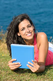 Communication and reading with tablet in summer Stock Photos