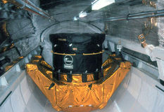 Communication satellite. Image of a communication satellite in a space shuttle carge bay Stock Photos