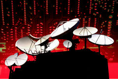 HIGH TECH TELECOMMUNICATIONS. Array of communication satellite dish antennas against a high tech circuit board industry technology telecommunication background Royalty Free Stock Photos