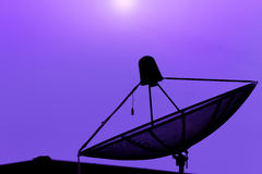 Communication satellite dish on the roof with sunset sky backgro Royalty Free Stock Photography