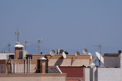 Communication and satellite dishes. Satellite and communication dishes on hotel roof. Air condition units on hotel roof Royalty Free Stock Photos