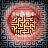 Communication Solutions. Business concept as a human open mouth with a maze background texture as a metaphor for uncertain direction and questions on a confused Stock Photography