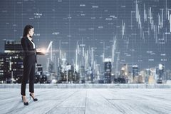 Communication and stats concept. Young businesswoman on rooftop using laptop with forex chart and night city view. Communication and stats concept. Double stock photography