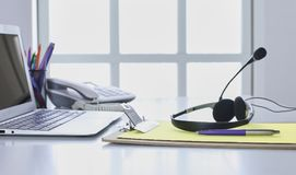 Communication support, call center and customer service help desk. VOIP headset on laptop computer keyboard.  royalty free stock images