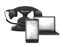 Communication symbols - laptop and phones Royalty Free Stock Photo