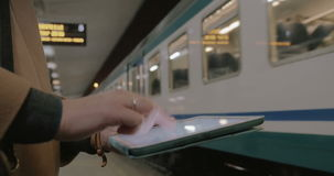 Communication with tablet PC in subway stock video footage