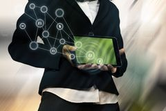 Cropped body holding a tablet over symbol and abstract background Royalty Free Stock Photography