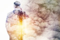 Communication and telecommunication conception. Double exposure business man using phone with cell tower and white cloud, communication business concept Stock Image