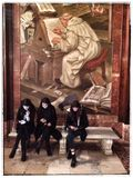 Communication. Three women texting in front of an old painting of a scribe at the New York Public Library. Clash of digital and analogue. Cyber culture Stock Images