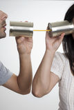 Communication with tin cans. Concept about communications with 2 tin cans and a string, in white background, isolated Stock Photo
