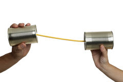 Communication with tin cans. Concept about communications with 2 tin cans and a string, in white background, isolated Royalty Free Stock Photos
