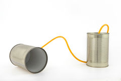 Communication with tin cans. Concept about communications with 2 tin cans and a string, in white background, isolated Stock Photos
