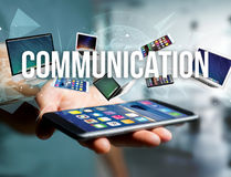 Communication title surounded by device like smartphone, tablet. View of a Communication title surounded by device like smartphone, tablet or laptop - Internet Royalty Free Stock Images