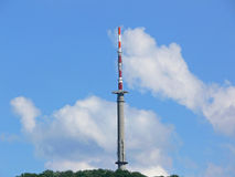 Communication tower. Against the blue sky Stock Photo