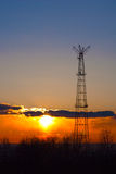 Communication tower. Communication tower against sunset background Royalty Free Stock Images
