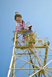 Communication tower. Over blue sky royalty free stock image