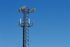 Communication tower. A communication tower against a clear blue sky Royalty Free Stock Image