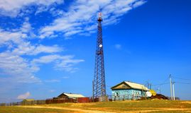 Communication tower. Village. Communication tower.  Cloudy sky Stock Photography