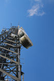 Communication tower. Telecommunications tower transmitting television and telephone signals Stock Image