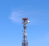 Communication tower. Against the blue sky royalty free stock photo