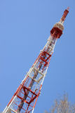 Communication tower. Against the blue sky Royalty Free Stock Image