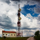 Communication tower. From a rural landscape. The image have stormy cloud in the background Royalty Free Stock Image