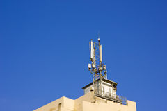 Communication tower. Over building,mobile tower over building Stock Image
