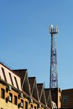 Communication Tower. Cellular communication antenna on a roof of a building Stock Images
