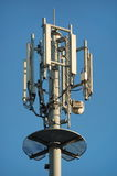 Communication tower. GSM communication tower top with a range of antennas royalty free stock photo