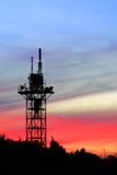 Communication tower. Silhouette on sunset sky Royalty Free Stock Photo