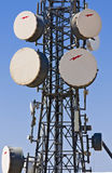 Communication tower. With parabolic antennas enclosed in domes Stock Photo