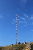 Communication tower against the blue sky Stock Photos
