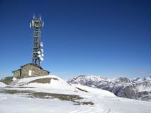 Communication tower in Alps royalty free stock photography