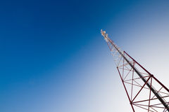 Communication tower and blue sky. Communication tower against gradient blue sky Stock Images
