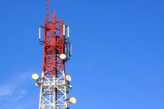 Communication tower. With blue sky Royalty Free Stock Image