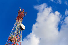 Communication tower on blue sky and clouds Royalty Free Stock Image