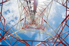 Communication tower. Bottom view of a communication tower with blue sky background Stock Photography