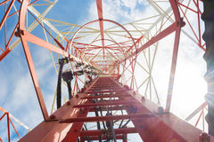 Communication tower. Bottom view of a red communication tower Royalty Free Stock Photos