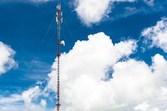 Communication tower and cellphones with blue sky. Communication tower and cellphones with clear blue sky Royalty Free Stock Images
