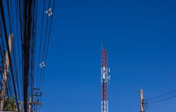 Communication tower and cellphones with blue sky. Communication tower and cellphones with clear blue sky Stock Images