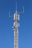 Communication tower with GSM and radio devices Royalty Free Stock Photography