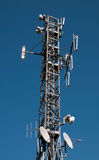Communication Tower: Gsm, Umts, 3G and radio. Communication cell tower for wireless technology: Gsm, Hsdpa, Umts, Gprs, Edge, Hsupa, 3G and radiotelevision Royalty Free Stock Images