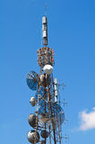 Communication tower over a blue sky. Royalty Free Stock Photography