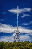 Communication tower radio mast with antenna aerial Royalty Free Stock Photo